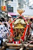 Portable golden shrine worshiped in Tenjin Matsuri, the biggest. Osaka - July 25, 2012: A Portable golden shrine worshiped in Tenjin Matsuri, the biggest Royalty Free Stock Photos