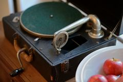 Portable Gramophone Victrola with Apples in bowl Royalty Free Stock Photo