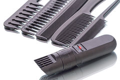 Portable hair clipper and combs. Portable hair clipper with zoom trimmer and black combs isolated on a white background royalty free stock photography