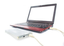 Portable hard drive and laptop computer Royalty Free Stock Photography
