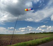 Portable indicator wind on the edge of cornfields Royalty Free Stock Photos
