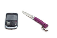 The phone and the knife Stock Images