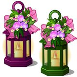 Portable lantern with candles decorated flowers and Easter eggs Royalty Free Stock Photos
