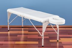 Portable Massage Table in room on the wooden floor, 3D rendering Stock Image