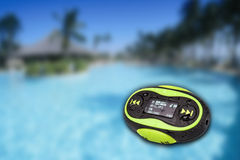 Portable mini MP3 with paradise background Royalty Free Stock Photo