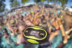 Portable mini MP3 waterproof party background. Portable mini MP3 waterproof resistance with swimming pool party background Stock Image