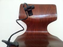 Portable mobile phone holder with long cord attached to wooden chair royalty free stock photos