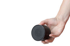Portable mobile speaker keeps men right hand Stock Photography