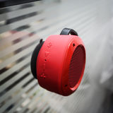 Portable music column. Attached to the wall on the suction Cup, red color, all buttons play, stop, volume Stock Image