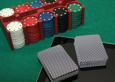 Portable online casino. 21st century casino - online casino. Deck of cards, chip, and tablet royalty free stock image
