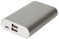 Portable power bank isolated. Portable power bank silver case for charging mobile devices isolated Royalty Free Stock Photos