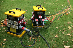 Portable power distribution units. It's a device fitted with multiple outputs designed to distribute electric power outdoors Stock Image
