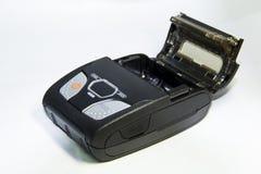 Portable printer. A very small portable printer in an open state Stock Photography