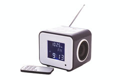Portable radio receiver. With alarm, card-reader, amplifier,  remote control and MP3 player isolated on a white background Royalty Free Stock Photography