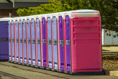 Portable Restrooms In Row. Public Portable Restroom Stacked In Row Stock Images