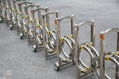 Portable road blocker. Portable road blocker metal stainless steel on asphalt road stock photos