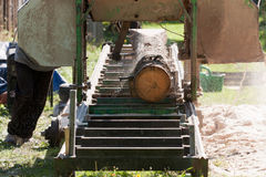 Portable sawmill. Processing raw timber to planks Royalty Free Stock Photos