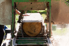 Portable sawmill. A man cutting timber on a portable sawmill Royalty Free Stock Images