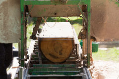 Portable sawmill. Processing raw timber to planks Royalty Free Stock Images