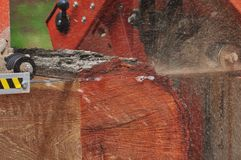 Portable Sawmill. Band saw removing slab from red oak log Stock Photography