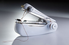Portable Sewing Machine. In mood lighting Royalty Free Stock Photography