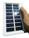 portable solar cell in hand Stock Image