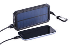 Portable solar charger for smart phone. royalty free stock images
