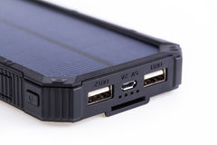 Portable solar charger for smart phone. Royalty Free Stock Photography