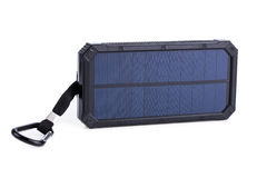 Portable solar charger for smart phone. Stock Photo
