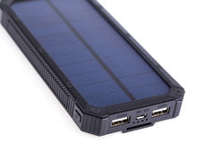Portable solar charger for smart phone. Stock Photography