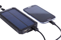 Portable solar charger for smart phone. Stock Images