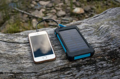 Portable solar panel for charging mobile devices Royalty Free Stock Images