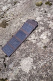 Portable solar panels lie on the shore and accumulate energy. Stock Images