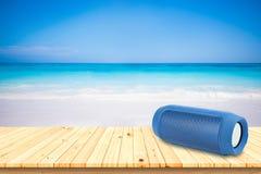 Portable speaker on the beach. Stock Images