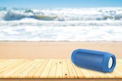 Portable speaker on the beach. Stock Image