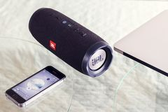 Portable speaker JBL Сharge 3 and iPhone Stock Images