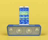Portable speaker and smartphone Royalty Free Stock Photography