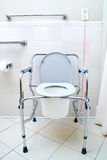 Portable Toilet. A Portable Toilet in a hospital patients latrine stock image