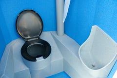 Portable toilet. Blue and black portable toilet Stock Image