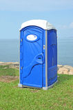 Portable Toilet. Blue Portable Toilet In The Park Royalty Free Stock Images