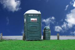 Portable Toilet. And trash can against blue sky Stock Photo
