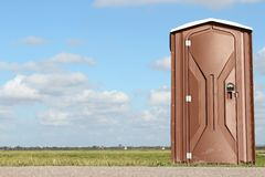 Portable toilet. Near construction site Royalty Free Stock Image