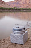 Portable toilet on a shore of southwestern river Stock Photos