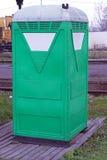 Portable toilet. Temporary portable green toilet cabin Royalty Free Stock Image