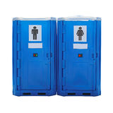 Portable toilet. Two blue plastic portable toilet cabins isolated Royalty Free Stock Image