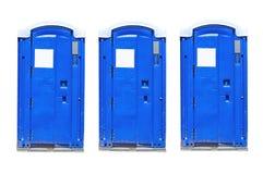 Portable toilets. Three portable toilets isolated on white Royalty Free Stock Photo
