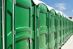 Portable toilets. The line of portable toilets Stock Photos