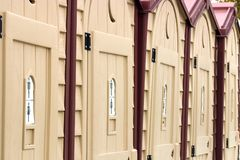 Portable toilets. Port-a-potty  Row of outside toilets Royalty Free Stock Image