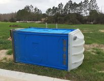 Portable toilets. Blowed by a big wind Stock Photo