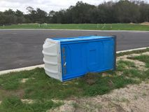 Portable toilets. Blowed by a big wind Royalty Free Stock Photography